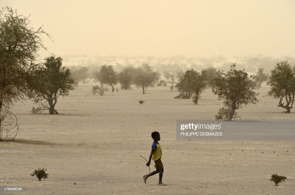 A young boy walks on June 4 on the dry lake of Faguibine near Bintagoungou in the region of Timbuktu northern Mali while French soldiers of the 93rd...