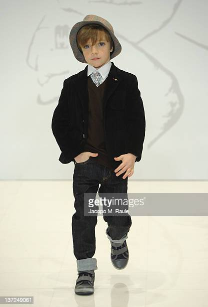 A young boy walks the runway during the Roccobarocco fashion show as part of Milan Fashion Week Menswear Autumn/Winter 2012 on January 17 2012 in...