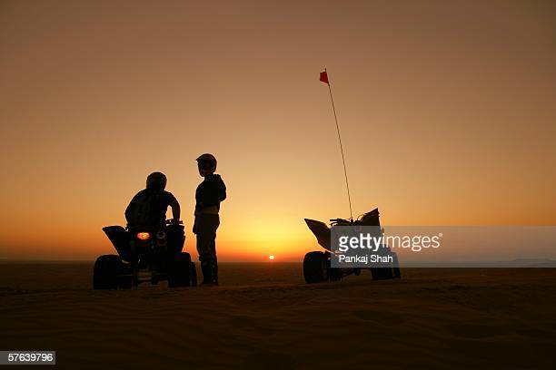 Young boy watch his father in a sand cruising