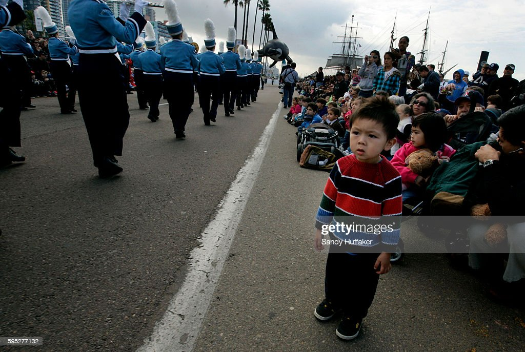 A young boy watches a Giant Balloon parade during the Pacific Life Holiday Bowl Parade in San Diego California Arizona and Nebraska play in the...