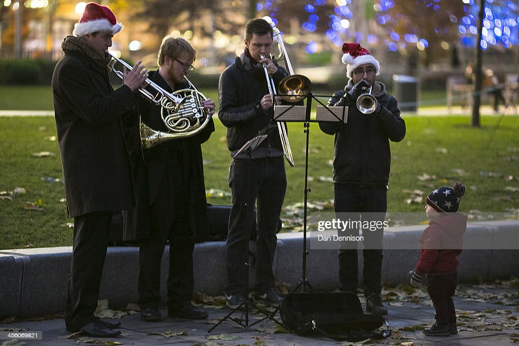 A young boy watches and listens to a brass band play Christmas carols at the German Christmas Market being held on the South Bank on December 13 2013...