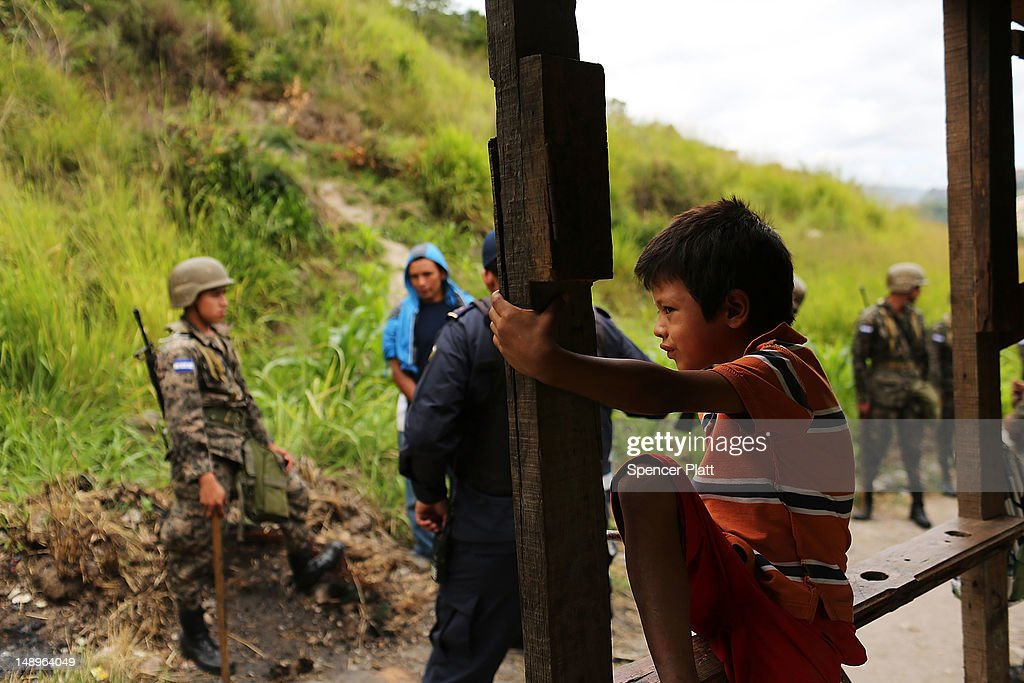 A young boy watches as his home and neighborhood are forcefully dismantled in a shanty town after the government claimed that the settlement was...