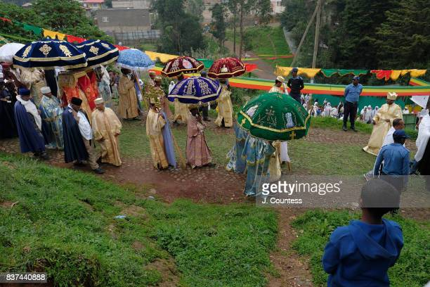 A young boy watches as priests carrying the Tabot a representation of the Ark of the Covenant lead followers of the Ethiopian Orthodox Tewehedo faith...