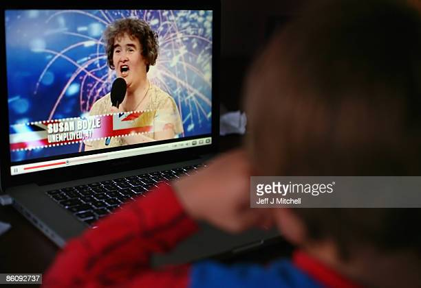 A young boy watches Britain's Got Talent contestant Susan Boyle on You Tube on April 21 2009 in Glasgow Scotland Ms Boyle has become a worldwide...