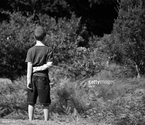 Young boy watching the world away