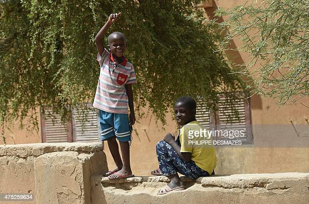 A young boy waves to French soldiers of Operation Barkhane an antiterrorist operation in the Sahel patrolling in Gao northern Mali on May 30 2015...