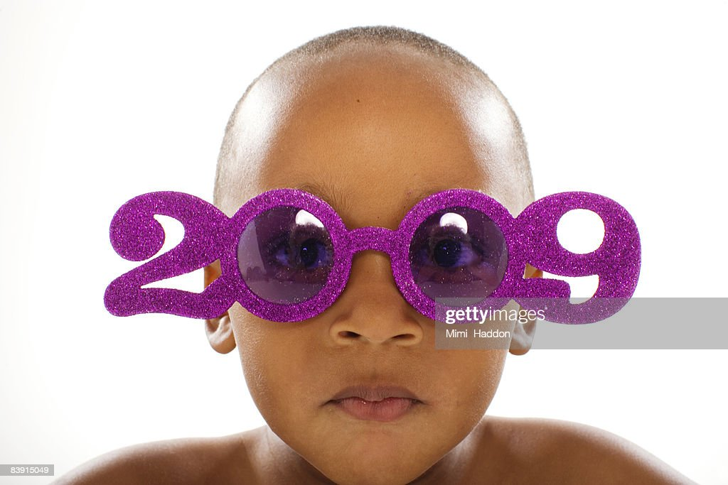 young boy wearing 2009 glasses : Stock Photo