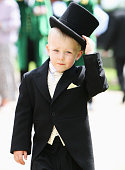 A young boy wearing a morning suit and top hat attends Ladies Day at Royal Ascot racecourse on June 19 2008 in Ascot England Today was the third day...