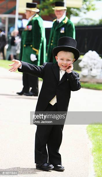 A young boy wearing a morning suit attends Ladies Day at Royal Ascot racecourse on June 19 2008 in Ascot England