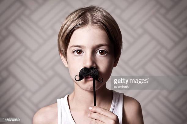 Young Boy Wearing a Mustache