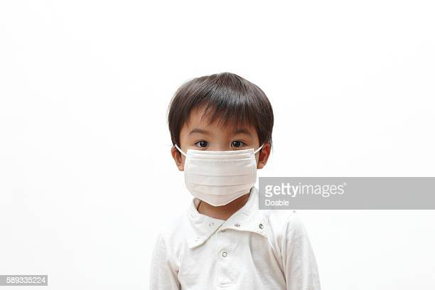 Young boy wearing a surgical mask