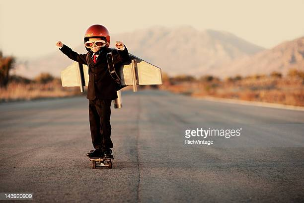 Young Boy Wearing Business Suit and Jet Pack