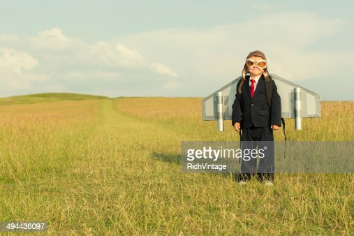 Young Boy Wearing Business Suit and Jetpack