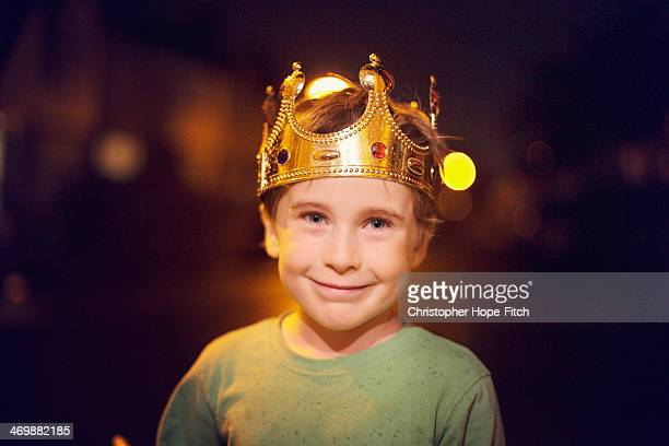Young boy wearing crown