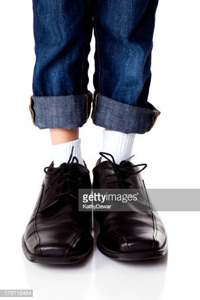 Young Boy Wearing Dads Shoes