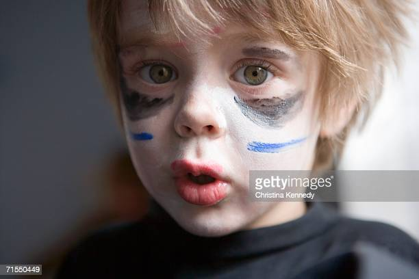 Young boy wearing face paint