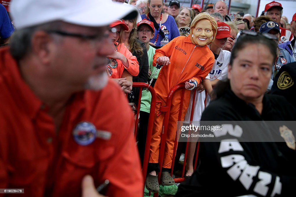 A young boy wears a Hillary Clinton mask during a rally with Republican presidential nominee Donald Trump in the Rodeo Arena at the Jefferson County Fairgrounds October 29, 2016 in Golden, Colorado. The Federal Bureau of Investigation announced Friday it discovered emails pertinent to the closed investigation of Democratic presidential nominee Hillary Clinton's private email server and are looking to see if they improperly contained classified information. Trump said 'I think it's the biggest story since Watergate.'