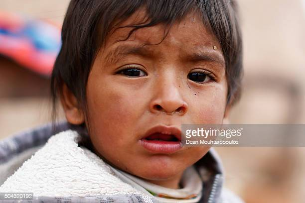 A young boy whose family live near the race course looks on as day 7 stage seven runs from Uyuni in Bolivia to Salta in Argentina during the 2016...