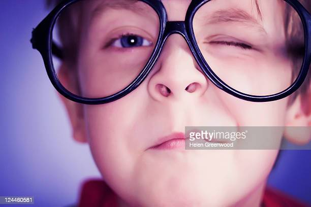 Young boy winking in comedy glasses