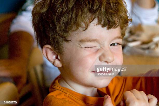 Young boy winking