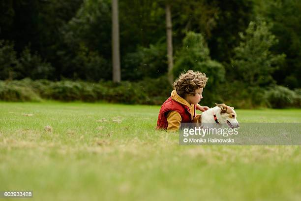 Young boy with a dog