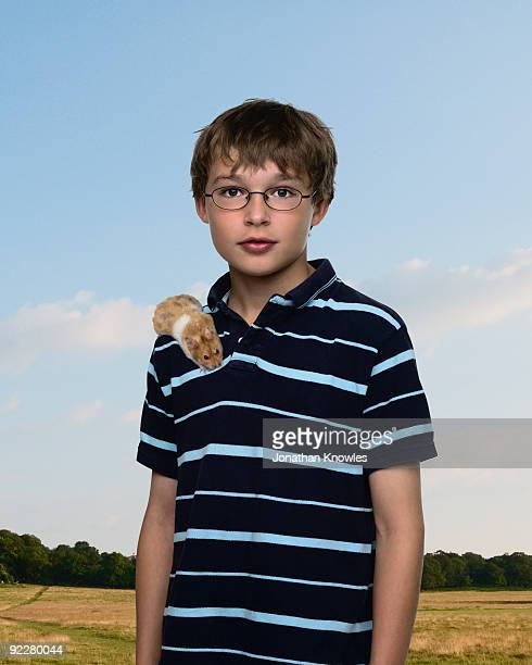 A young boy with a hamster