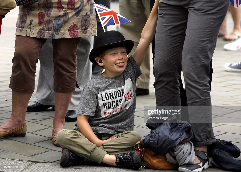 A young boy with a hearing impairment waits for the arrival of the Paralympic Torch ahead of the start of the London 2012 Paralympic Games for the arrival of Paralympic torch in Trafalgar Square on August 29, 2012, in London, England.