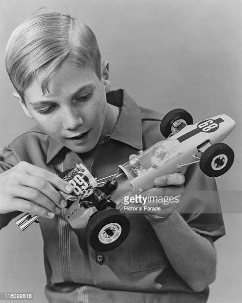 A young boy with a mileaminute model gasengine version of the Fordpowered Lotus racing car at the annual American Toy Fair in New York on March 08...