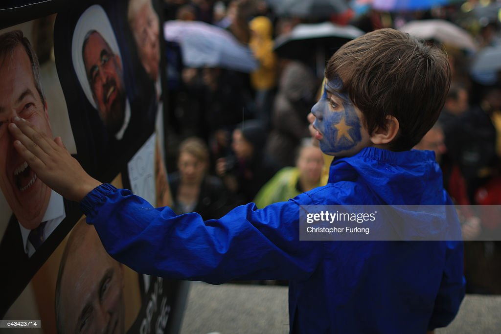 A young boy with an EU flag painted on his face joins protesters gathering against the EU referendum result in Trafalgar Square on June 28, 2016 in London, England. Up to 50,000 people were expected before the event was cancelled due to safety concerns. Early evening up to 2000 people have still convereged on the square to vent their anti-Brexit feelings.