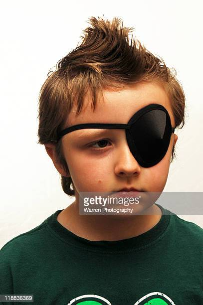Young boy with black eye patch