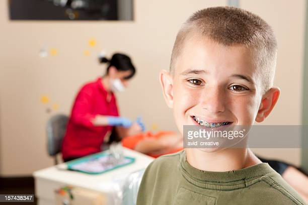 Young Boy with Braces at Orthodontist Office