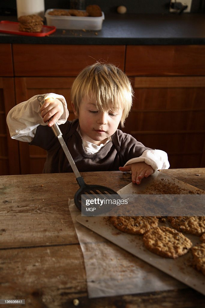Young boy with cookies : Stock Photo