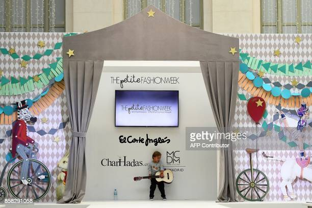 A young boy with Down Syndrome takes part in the rehearsals of 'The Petite Fashion Week' in Madrid on October 6 2017 Some of the models at the show...