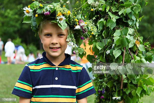 Young boy with flower wreath on head