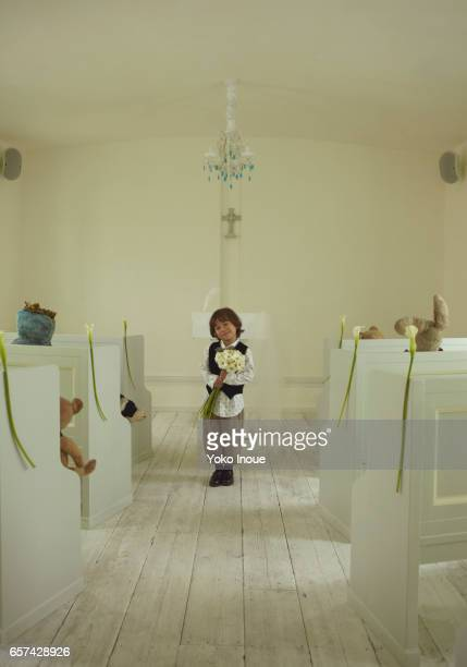 Young boy with flowers in wedding chapel