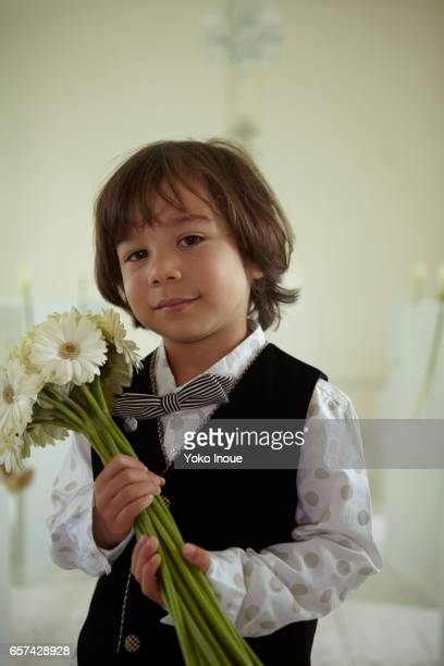 Young boy with flowers