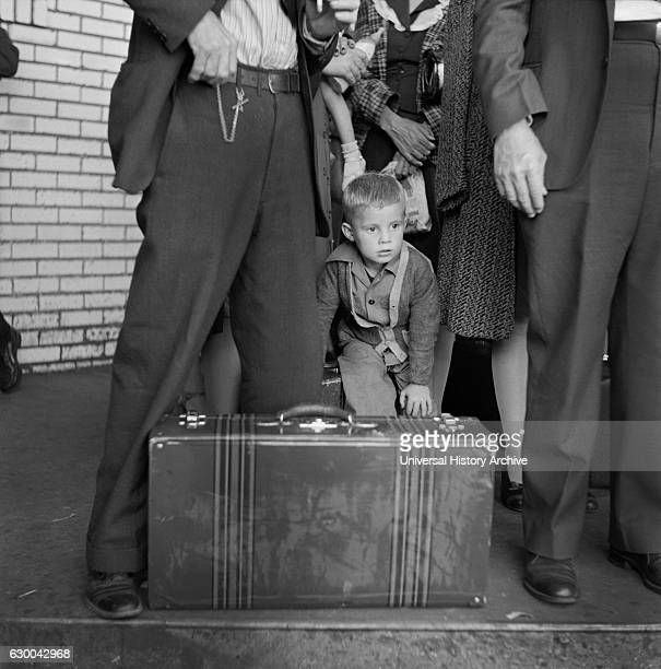 Young Boy with Group of People Waiting for Greyhound Bus during Trip from Louisville Kentucky to Memphis Tennessee USA Esther Bubley for Office of...