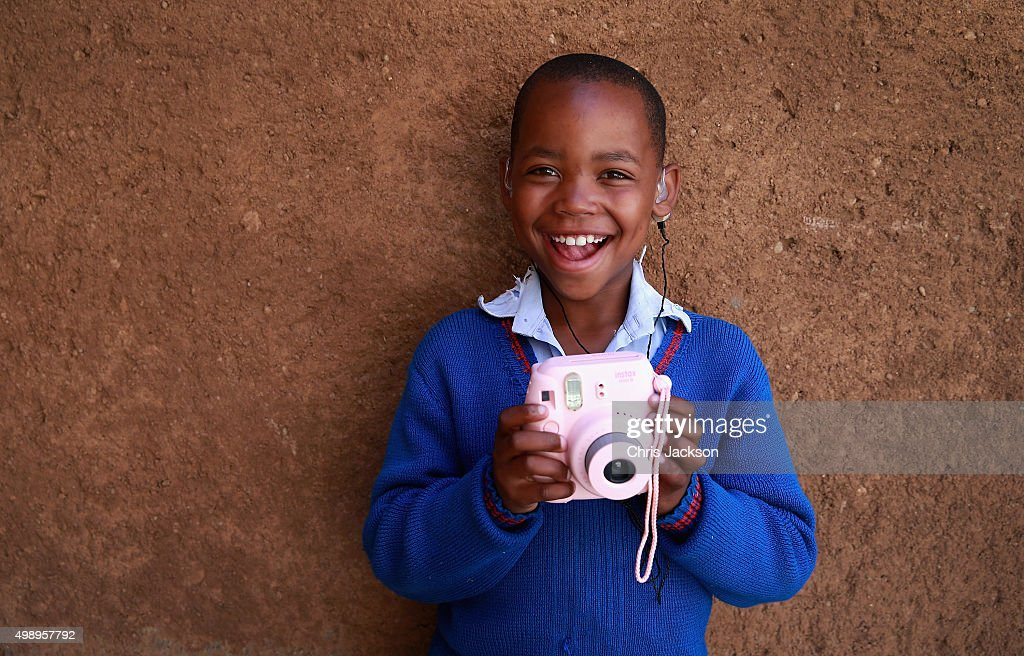A young boy with hearing difficulties uses a Fuji Instant Camera during a photography session at a community camp at the Sentebale Mamohato Children's Centre on October 17, 2015 in Maseru, Lesotho. Getty Images have partnered with Prince Harry's Charity Sentebale to help bring photography to some of the vulnerable children of Lesotho. In an ongoing project and with the Support of Fujifilm Getty Images has helped develop and run lessons with children at the new Sentebale Mamohato Children's Centre as a way of helping develop interpersonal, creative and communication skills amongst some of the most disadvantaged children in the world. Sentebale was founded by Prince Harry and Prince Seeiso of Lesotho ten years ago.