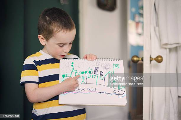 Young boy with his drawing
