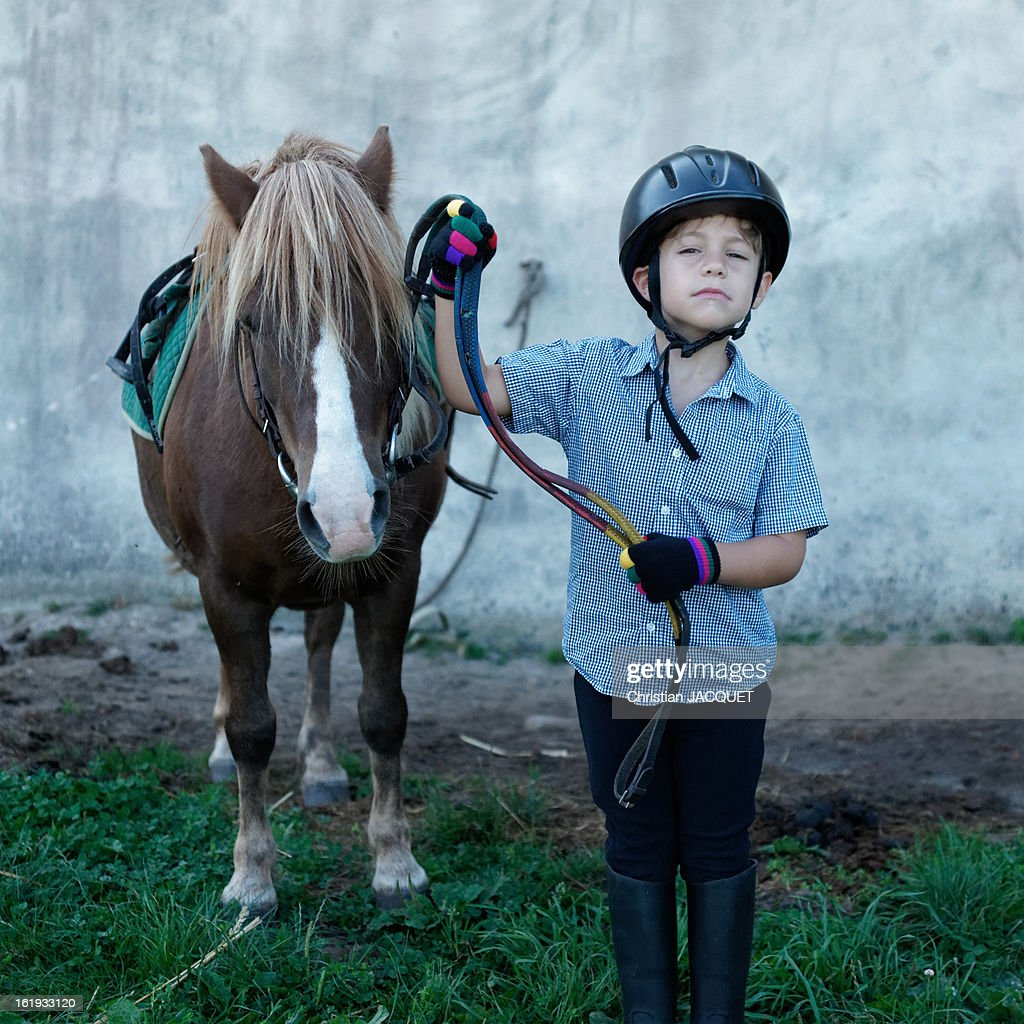 Young boy with his pony rider