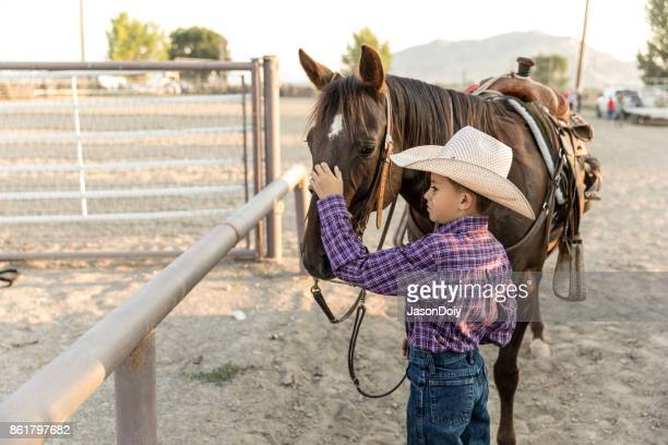 Young Boy With Horse on Authentic Ranch