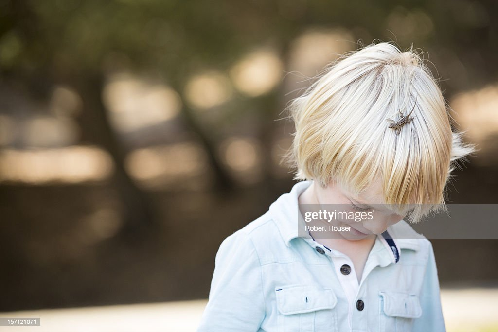 Young boy with lizard : Stock Photo