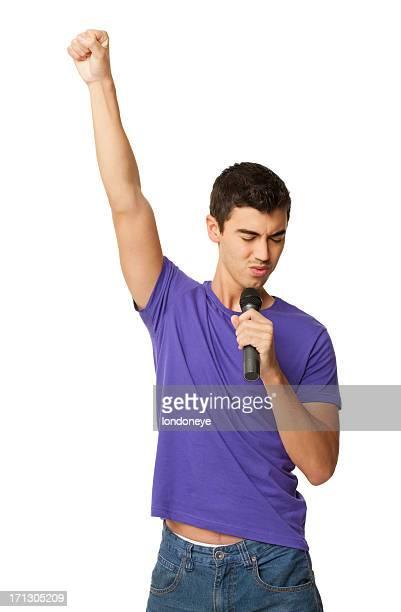 Jeune garçon avec un Microphone-isolé