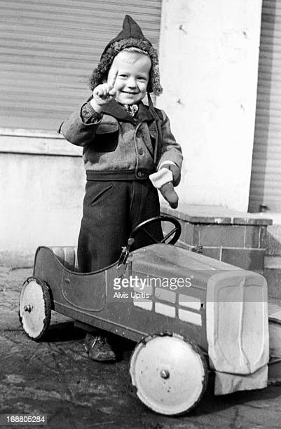 Young boy with play car.
