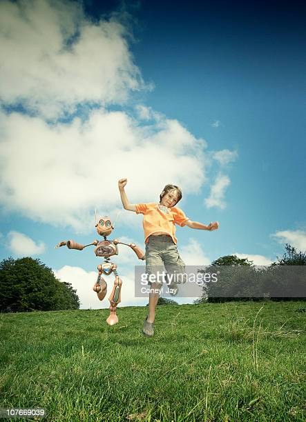 young boy with robot companion