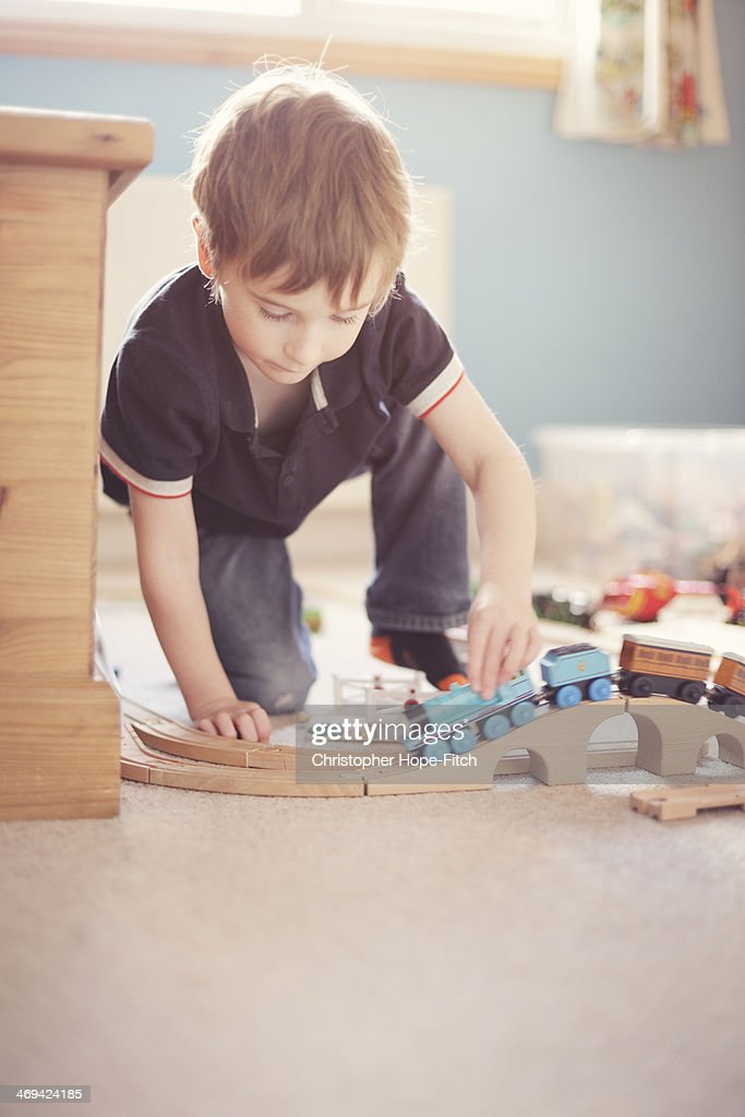 Young boy with toy trains