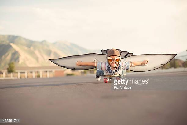 Young Boy with Wings Flies On Skateboard