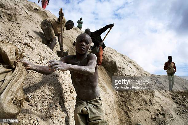 A young boy works among about 4000 artisan miners dig for copper on December 13 2005 in Ruashi mine about 20 kilometers outside Lubumbashi Congo DRC...