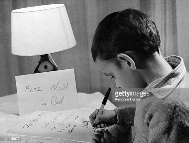 Young Boy Writing A Letter To Santa Claus In 1965