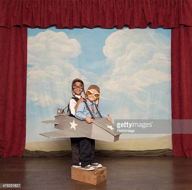 Young Boys and Pilots Flying Toy Plane